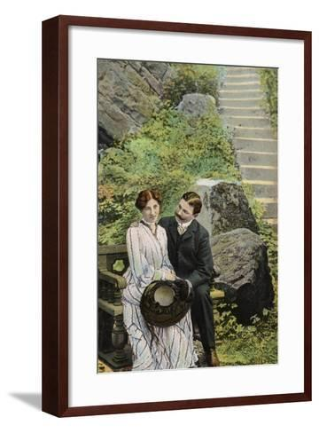 Couple Seated on a Stone Bench Near Some Steps--Framed Art Print