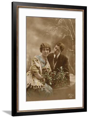 Couple with Mistletoe and Holly--Framed Art Print