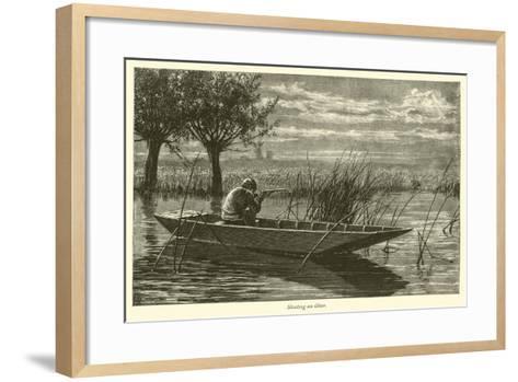 Shooting an Otter--Framed Art Print