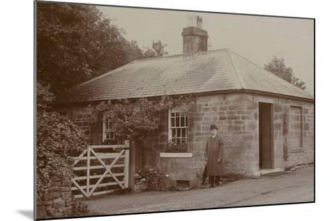 Man Outside a Bungalow--Mounted Photographic Print