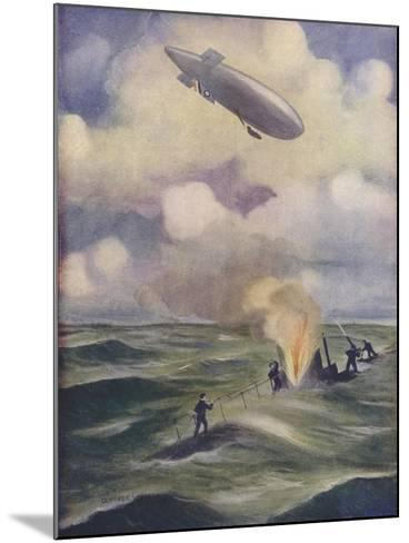 A British Naval Airship Bombing a Submarine--Mounted Giclee Print