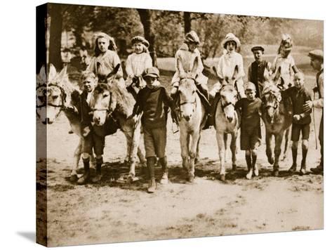 Children Donkey Riding on Hampstead Heath--Stretched Canvas Print