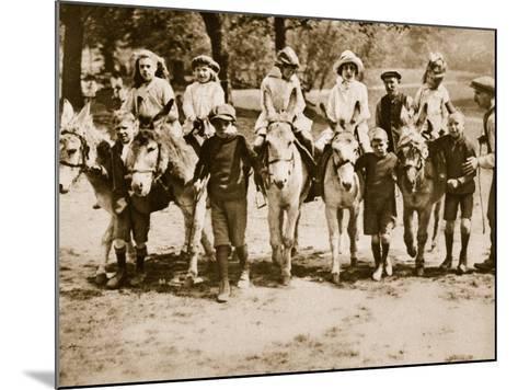 Children Donkey Riding on Hampstead Heath--Mounted Photographic Print