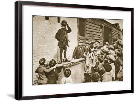 Child Imitating Charlie Chaplin--Framed Art Print