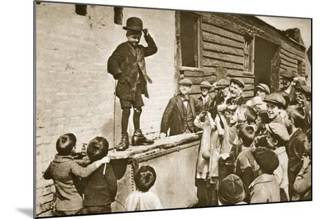 Child Imitating Charlie Chaplin--Mounted Photographic Print