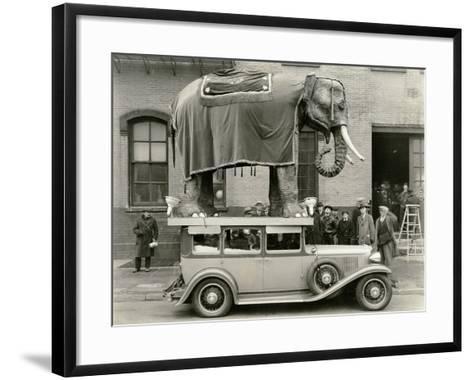 Model Elephant Atop a Vintage Motor--Framed Art Print