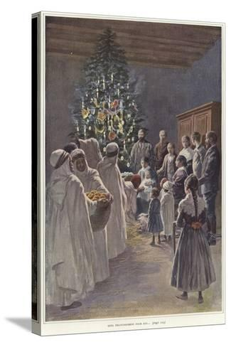 A Family Group Watching a Nativity Scene by a Christmas Tree--Stretched Canvas Print