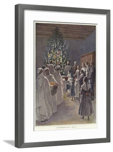 A Family Group Watching a Nativity Scene by a Christmas Tree--Framed Art Print