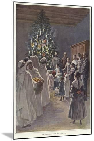 A Family Group Watching a Nativity Scene by a Christmas Tree--Mounted Giclee Print