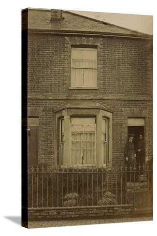 Two Women Standing in the Doorway of a Semi-Detached House--Stretched Canvas Print