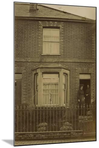 Two Women Standing in the Doorway of a Semi-Detached House--Mounted Photographic Print