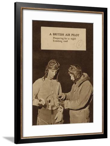 A British Air Pilot Preparing for a Night Bombing Raid, World War II--Framed Art Print