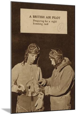 A British Air Pilot Preparing for a Night Bombing Raid, World War II--Mounted Photographic Print