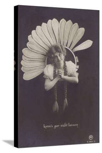 A Young Woman with Long Plaits Sticks Her Head Through a Flower--Stretched Canvas Print