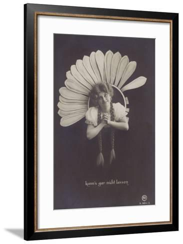 A Young Woman with Long Plaits Sticks Her Head Through a Flower--Framed Art Print
