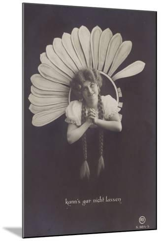 A Young Woman with Long Plaits Sticks Her Head Through a Flower--Mounted Photographic Print