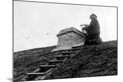 Patrick Kilcourse Pushes the Goose Down the Chimney, Early 20th--Mounted Photographic Print