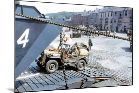A United States Army Ambulance Jeep Boarding a Landing Craft Transport--Mounted Photographic Print