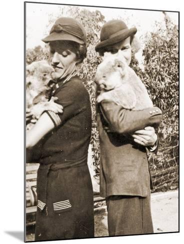 Visitors Holding Koalas at Taronga Zoo, Sydney, Australia. 1932--Mounted Photographic Print