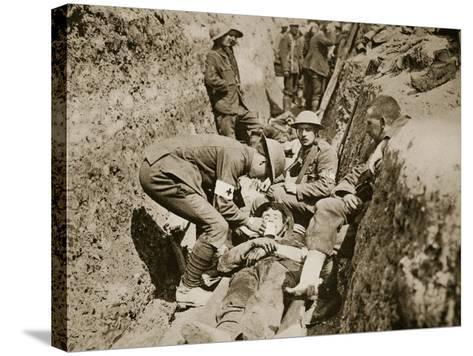 Red Cross Men in the Trenches Attending to a Wounded Man, 1916--Stretched Canvas Print
