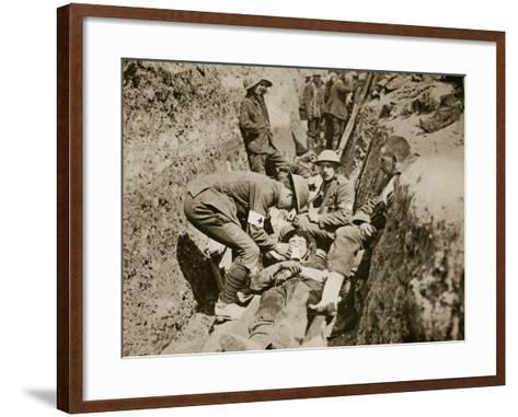 Red Cross Men in the Trenches Attending to a Wounded Man, 1916--Framed Art Print