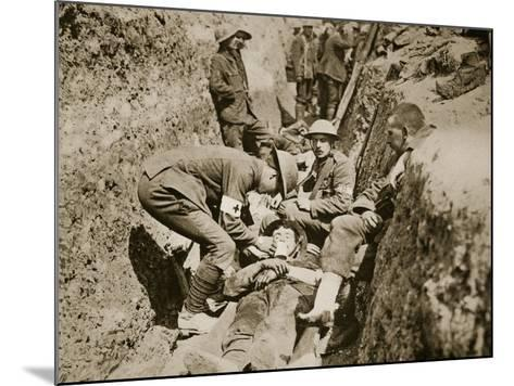 Red Cross Men in the Trenches Attending to a Wounded Man, 1916--Mounted Photographic Print