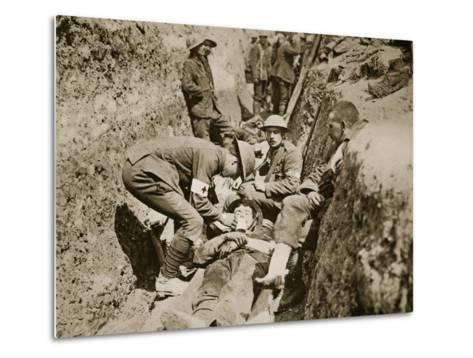 Red Cross Men in the Trenches Attending to a Wounded Man, 1916--Metal Print