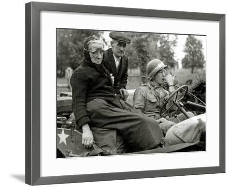 An Elderly Couple Sitting in a Jeep Driven by a Military Police--Framed Art Print