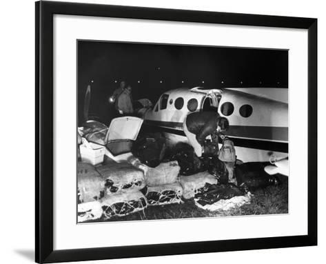 Bales of Marijuana Spill Out from a Crashed Cessna Plane, 1978--Framed Art Print