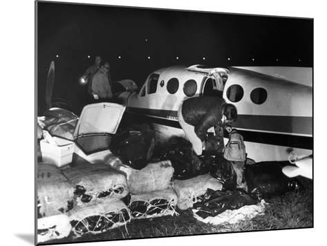 Bales of Marijuana Spill Out from a Crashed Cessna Plane, 1978--Mounted Photographic Print