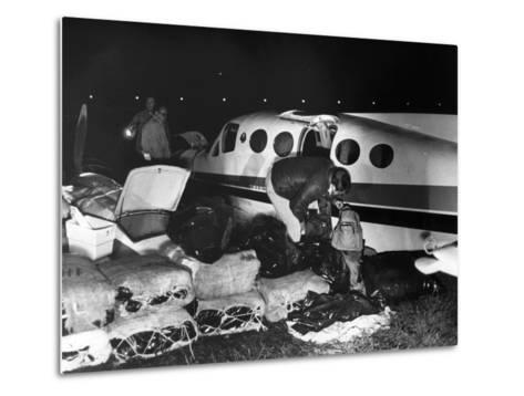 Bales of Marijuana Spill Out from a Crashed Cessna Plane, 1978--Metal Print