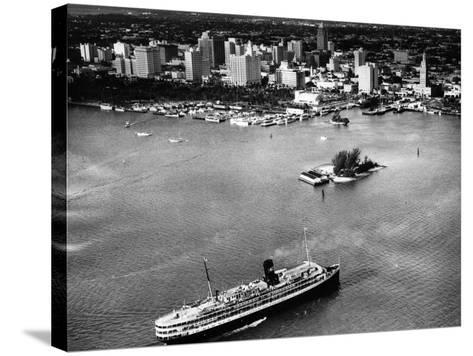 The SS Florida Goes to Sea, with Downtown Miami in the Background, 1953--Stretched Canvas Print