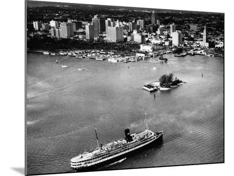 The SS Florida Goes to Sea, with Downtown Miami in the Background, 1953--Mounted Photographic Print