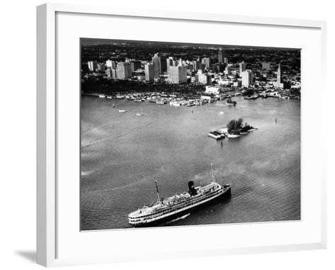 The SS Florida Goes to Sea, with Downtown Miami in the Background, 1953--Framed Art Print
