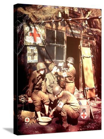 U.S. Army Medics are Treating Two Gis, Southern England, 1944--Stretched Canvas Print