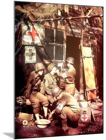 U.S. Army Medics are Treating Two Gis, Southern England, 1944--Mounted Photographic Print