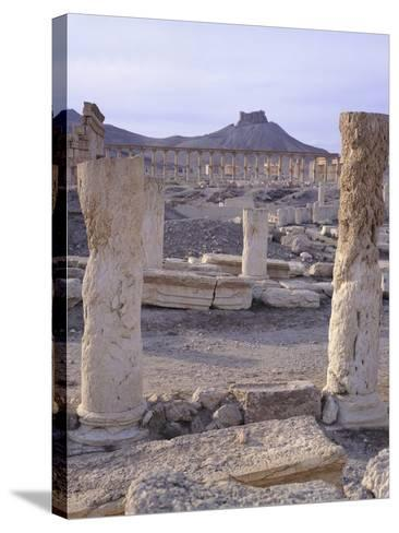Syria, Palmyra, View of Ruins with Umayyad Fortress in Background--Stretched Canvas Print