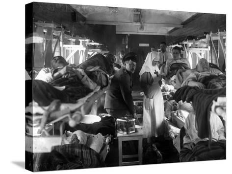 Nurses Tending the Wounded on a Red Cross Train, C.1915--Stretched Canvas Print