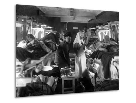 Nurses Tending the Wounded on a Red Cross Train, C.1915--Metal Print