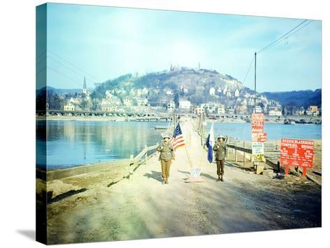 Two American Soldiers Guarding the Rozisch Blackburn Thompkins Bridge across the Rhine Near Remagen--Stretched Canvas Print