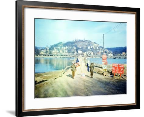 Two American Soldiers Guarding the Rozisch Blackburn Thompkins Bridge across the Rhine Near Remagen--Framed Art Print