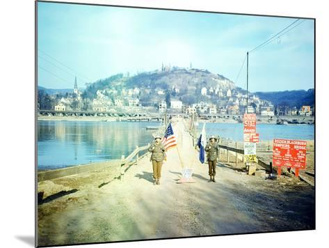 Two American Soldiers Guarding the Rozisch Blackburn Thompkins Bridge across the Rhine Near Remagen--Mounted Photographic Print