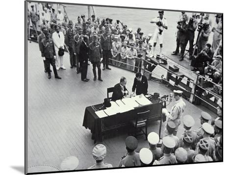 General Macarthur Reads Out the Terms of Surrender to Japanese Officials on Board the USS Missouri--Mounted Photographic Print