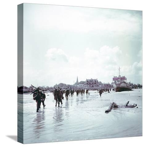 Troops of the 3rd Canadian Infantry Division Landing at Juno Beach Near Bernieres-Sur-Mer on D-Day--Stretched Canvas Print