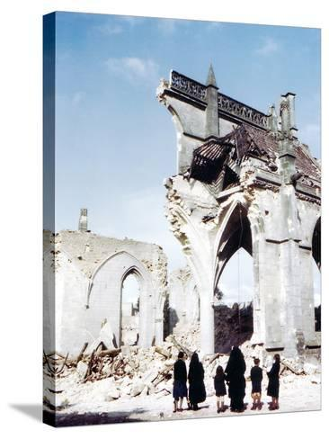 A Catholic Nun and Two Women with Children Standing in Front of the Ruins of Eglise Saint-Malo--Stretched Canvas Print