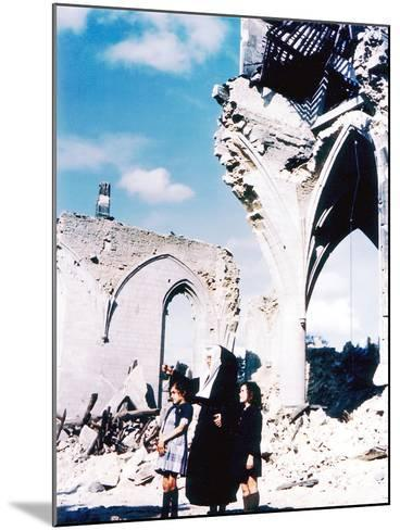 A Catholic Nun and Two Women with Children Standing in Front of the Ruins of Eglise Saint-Malo--Mounted Photographic Print