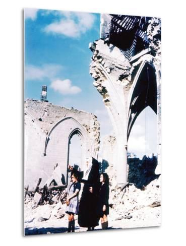 A Catholic Nun and Two Women with Children Standing in Front of the Ruins of Eglise Saint-Malo--Metal Print
