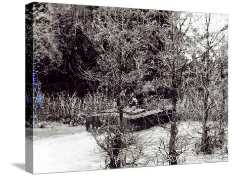 A River Patrol Boat Beaches to Land a Us Navy Seal Team in the Jungle to Hunt Viet Cong--Stretched Canvas Print