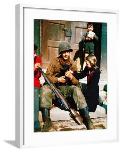 A Gi of the 9th U.S. Infantry Division Sitting in Front of a Door During the Battle of Aachen--Framed Art Print