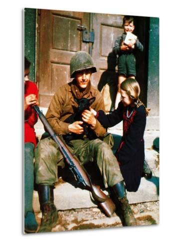 A Gi of the 9th U.S. Infantry Division Sitting in Front of a Door During the Battle of Aachen--Metal Print